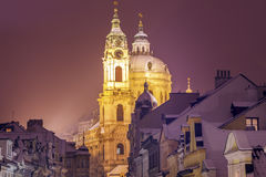 Winter in Prague - city panorama with St. Nicholas Church Stock Photo