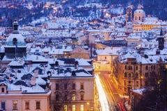 Winter in Prague - city panorama with St. Nicholas Church Stock Image