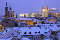 Winter in Prague - city panorama with St. Vitus Cathedral and St Royalty Free Stock Image