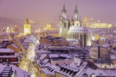 Winter in Prague - city panorama with Tyn Cathedral and Clock To Royalty Free Stock Photography