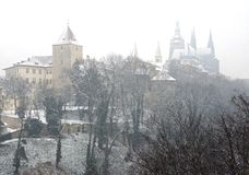 Winter in Prague comes at march suddenly. View of Prague castle during the heavy snow Royalty Free Stock Photo