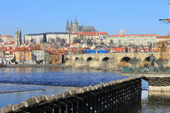 Winter Prague gothic Castle with Charles Bridge Stock Images