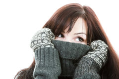 Winter pretty girl. Cute young woman in sweater and mitten Royalty Free Stock Image