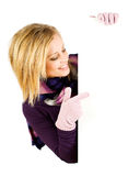 Winter: Pretty Girl Pointing To White Card Royalty Free Stock Photo