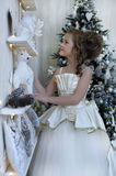 Winter princess at the Christmas tree Royalty Free Stock Images