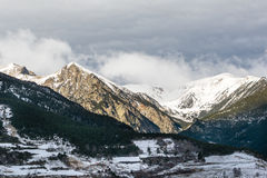 Winter Pyrenees landscape: icy mountain peaks, lightened with bright sun and rocky terrace in shadows. Pyrenees, Spain Stock Photography