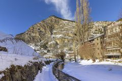 Winter pyrenes landscape near Village of Canillo, trekking and cycling trail. Royalty Free Stock Photo