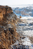 Winter quarry. General view of a stone-pit in the winter.Heavy stoning  machine in a quarry Royalty Free Stock Photos