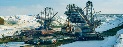 Winter in quarry. Production of manganese ore in the largest field in Europe. Open development. Huge machines of manganese ore mined in open pits. Metallurgical Royalty Free Stock Images