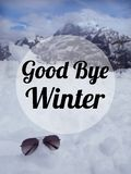 Winter quote. Quote `good bye winter` on blurred snow mountain background Royalty Free Stock Images