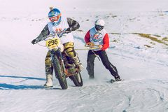 Winter race with mortcycles. Fast engins and big power. Latvia, City Cesis. Winter Red Bull motorcycle race. Snow, Red bull command and drivers. 2015 december royalty free stock photo