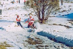 Winter race with mortcycles. Fast engins and big power. Latvia, City Cesis. Winter Red Bull motorcycle race. Snow, Red bull command and drivers. 2015 december stock photo