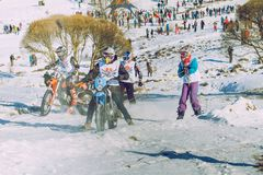 Winter race with mortcycles. Fast engins and big power. Latvia, City Cesis. Winter Red Bull motorcycle race. Snow, Red bull command and drivers. 2015 december stock photos