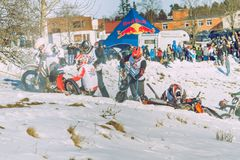 Winter race with mortcycles. Fast engins and big power. Latvia, City Cesis. Winter Red Bull motorcycle race. Snow, Red bull command and drivers. 2015 december royalty free stock images