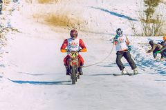 Winter race with mortcycles. Fast engins and big power. Latvia, City Cesis. Winter Red Bull motorcycle race. Snow, Red bull command and drivers. 2015 december royalty free stock photography