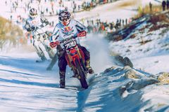 Winter race with mortcycles. Fast engins and big power. Latvia, City Cesis. Winter Red Bull motorcycle race. Snow, Red bull command and drivers. 2015 december stock images