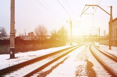 Winter railway landscape. Industrial zone. The railroad between stock images