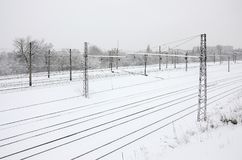 Winter railway landscape, Railway tracks in the snow-covered industrial country.  stock photography