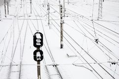 Winter railway landscape, Railway tracks in the snow-covered industrial country stock images