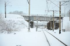 Winter railway landscape, Railway tracks in the snow-covered industrial country stock photo