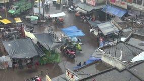 Winter rain in New Delhi Main bazaar street and vegetable seller Royalty Free Stock Photo