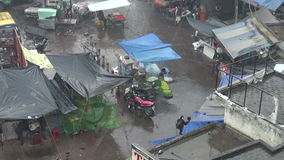 Winter rain in New Delhi Main bazaar street and vegetable seller stock video