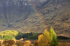 Winter rainbow, Glencoe, Scotland Royalty Free Stock Image