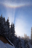 Winter rainbow in the mountains Royalty Free Stock Photos