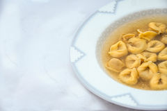 Winter recipe: broth with italian tortellini royalty free stock images