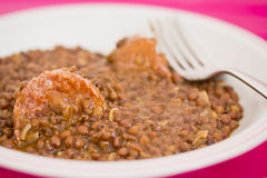Winter recipe: lentils and sausages Stock Photos