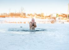 Winter recreation - swimming in  ice-hole Royalty Free Stock Photos