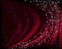 Winter red background with snowflakes. Royalty Free Stock Photography