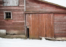 Winter red barn. Old red barn door in the winter Royalty Free Stock Image