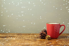 Winter red coffee cup with pine corn Stock Photos