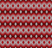 vector winter red knitted pattern Stock Image