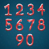 Winter red numbers set with snow caps. Frozen New year digits wi. Th snowflakes on it kit. Icicles numbers on dark snowy background Royalty Free Stock Photos