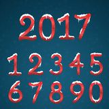 Winter red numbers set with snow caps. Frozen New year digits wi. Th snowflakes on it kit. Icicles numbers on dark snowy background Royalty Free Stock Image