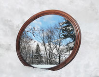 Winter Reflection. Reflection of winter scene in a mirror Stock Image