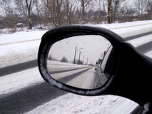 Winter reflection in the rearview mirror car Stock Images