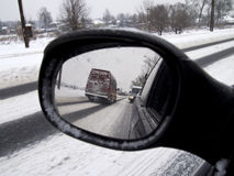 Winter reflection in the rearview mirror car Royalty Free Stock Photography