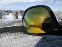 Winter reflection. In a set of sunglsses Stock Photos
