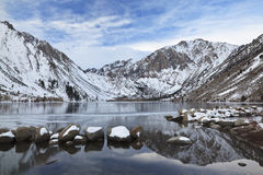 Winter reflections at a mountain lake Stock Photography