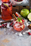 Winter refreshing cocktail with apples and cranberry Stock Photo