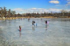 Winter rest. People walk on the frozen ice of the river Samara. Ukraine  city Novomoskovsk Dnipropetrovsk region. February 07, 2016 Royalty Free Stock Photos