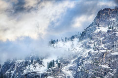 Winter Ridge. A winter ridgeline with low hanging clouds Royalty Free Stock Photos