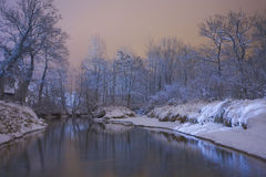 Winter river. Winter forest and river in monochromatic color at the night stock photo
