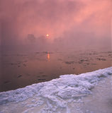 Winter river. Some ice in the morning fog ,beside the river Royalty Free Stock Photos