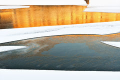 Winter river with bright reflection in water Royalty Free Stock Images
