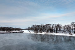 Winter river in a cloudy day Royalty Free Stock Photos