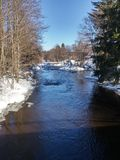 Winter river. River flowing in winter Royalty Free Stock Photo